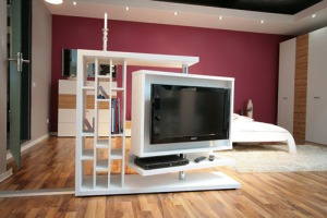 A wonderful TV unit that works like a space divider. This is perfect to separate out the living and dining area and offers tons of niches for decorative items and books.