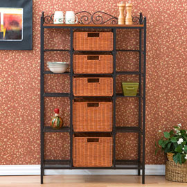 Notice how an old wrought iron cabinet has been given a distinct look by using wicker baskets. By utilizing the top most shelf for display as well, the entire rack cabinet has been effectively used for creating a simple yet impactful focal point.