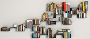 Simple wooden shelves put up in an interesting pattern along a long wall make for a great focal point