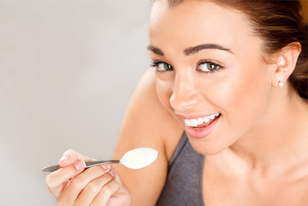 woman-eating-probiotics-yogurt-horiz