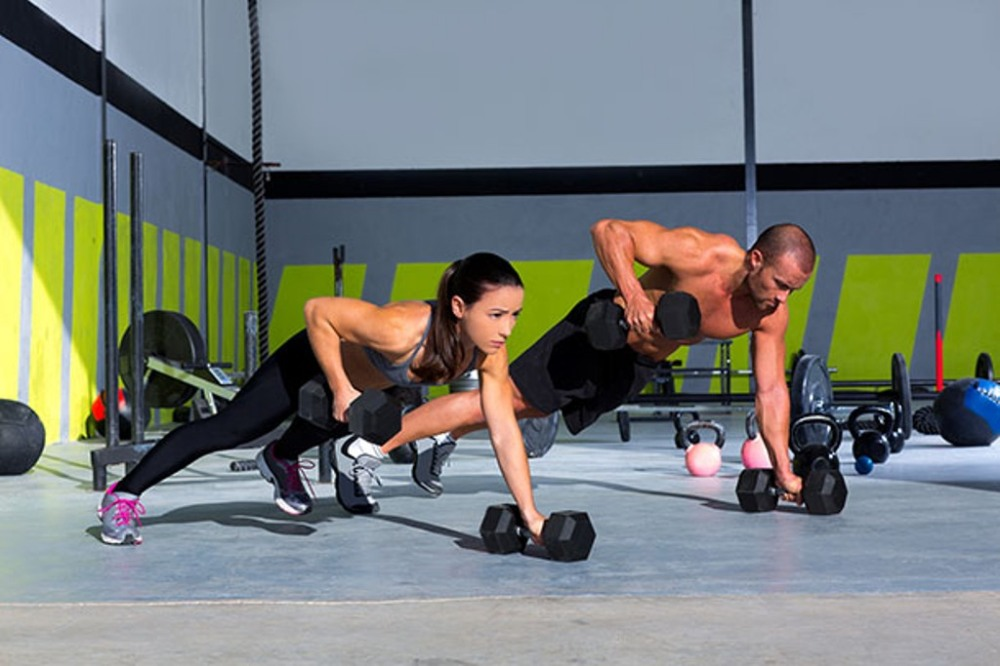 bigstock-Gym-man-and-woman-push-up-stre-40734724