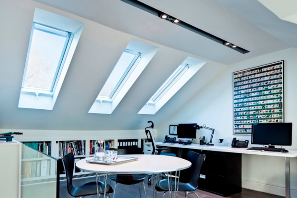 Notice how to skylights are bringing in a lot of additional natural light and also become an interesting design element