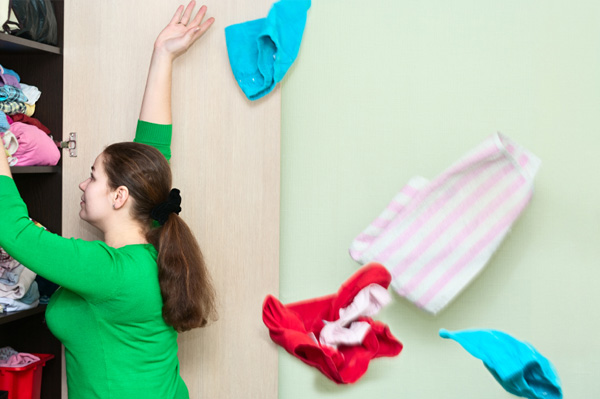 5. woman-cleaning-closet